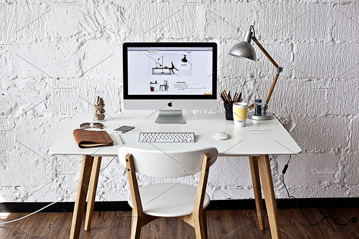 White-Workspace-With-iMac-700x466 iMac Mockup Collection: Free and Premium Computer Mockups (PSD)