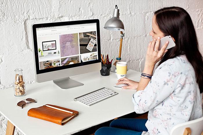 womanusing-700x467 iMac Mockup Collection: Free and Premium Computer Mockups (PSD)