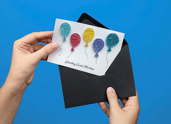 hand-Holding-Greeting-Card-PSD-Mockup Top greeting card mockup templates and designs to pick from
