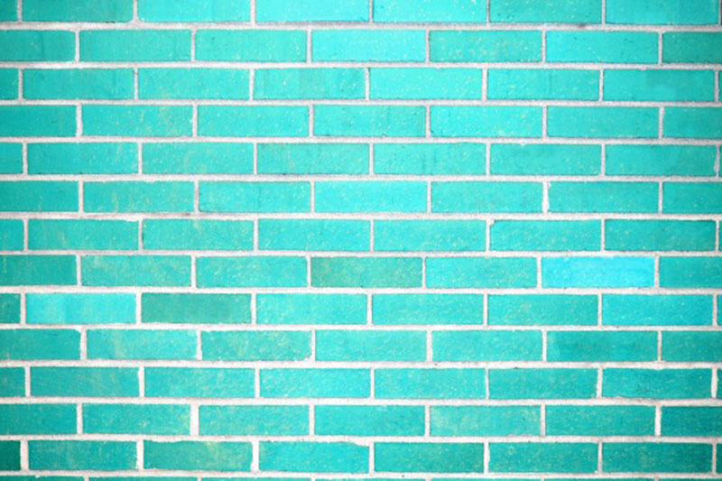 Teal-Brick-Wall-Texture-Strong-Colors Download a free brick wall background image now