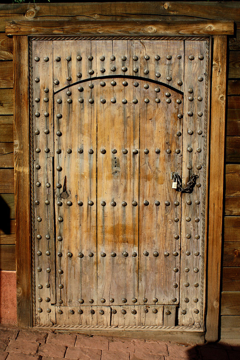 Old-World-Rustic-Wooden-Door-with-Bolts-and-Padlock-Doors-tell-a-story Rustic background images to download for your designs