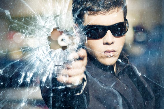 gunshot-through-a-glass 91 Photoshop Photo Manipulation Tutorials: Become A Pro